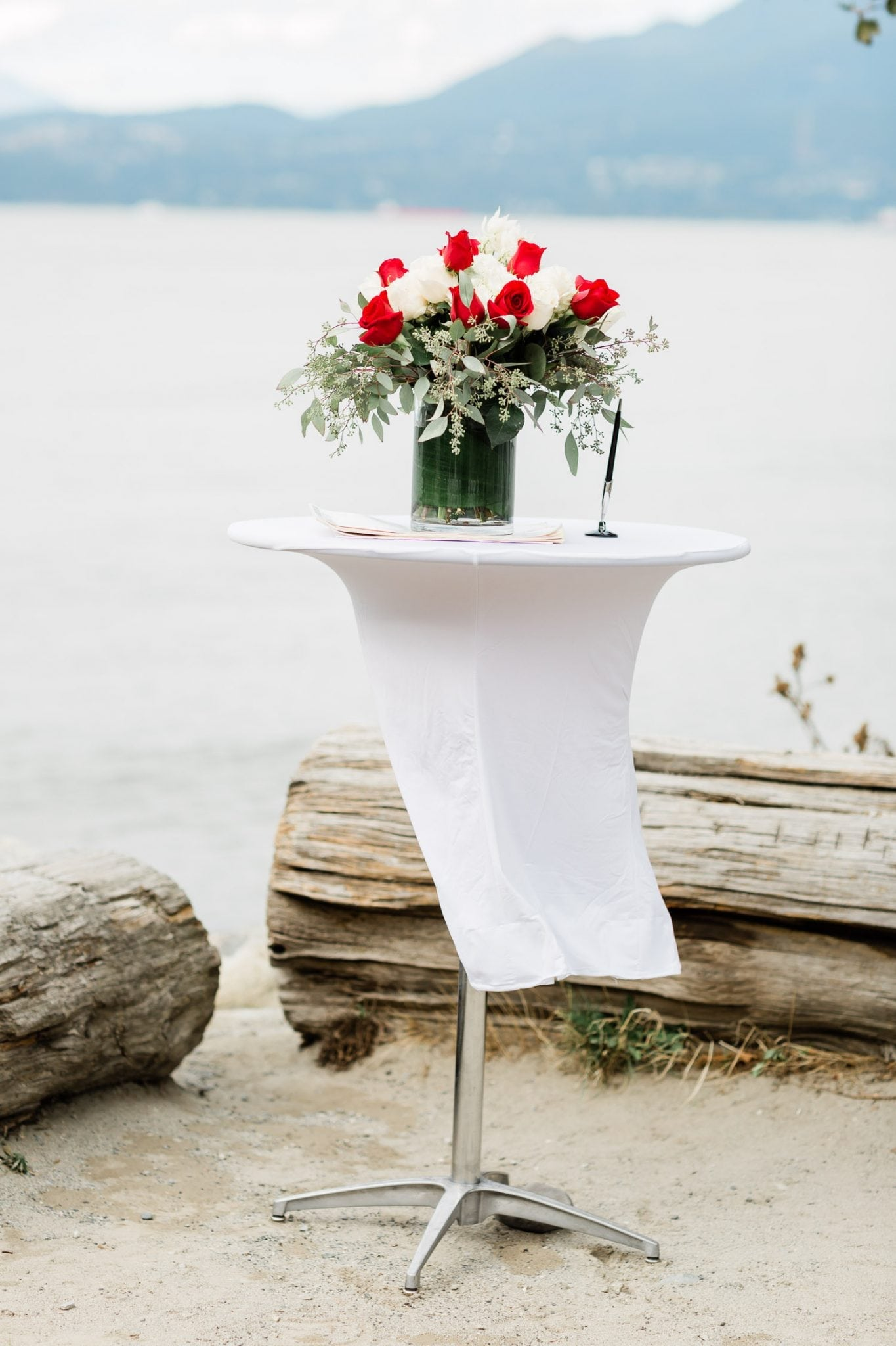 Wedding ceremony table with a bouquet | Vancouver wedding photographer