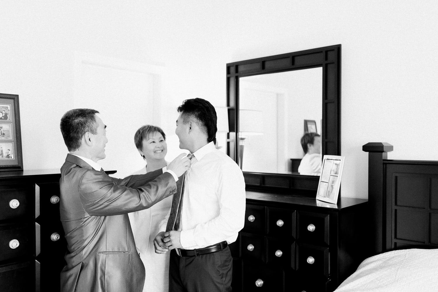Groom's preparation with parents helping | Vancouver wedding photographer | Westwood Plateau Golf Club Wedding