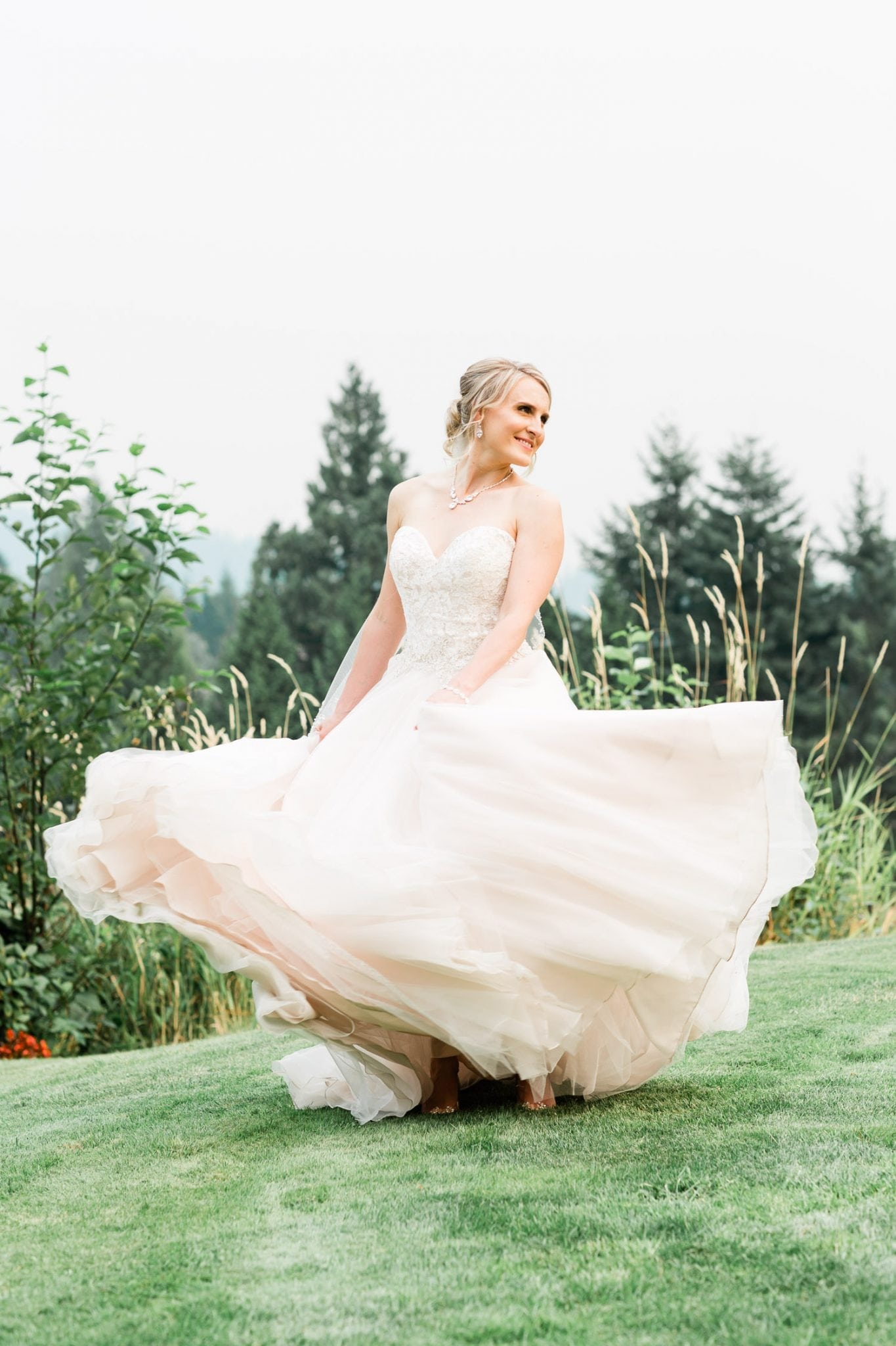 Bride portrait dancing on the grass | Vancouver wedding photographer | Westwood Plateau Golf Club Wedding