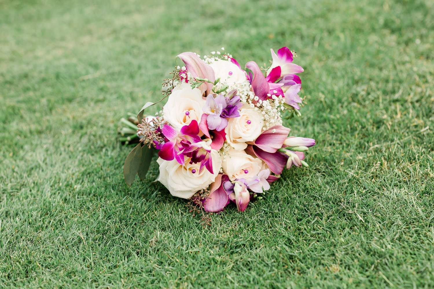 Wedding bouquet on the grass | Vancouver wedding photographer | Westwood Plateau Golf Club Wedding