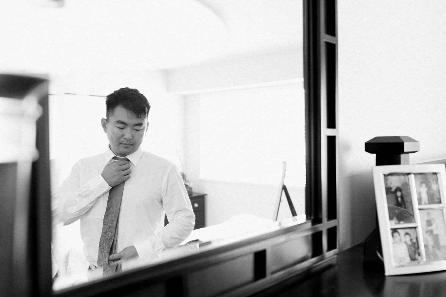 Groom during morning prep in front of the mirror | Vancouver wedding photographer | Westwood Plateau Golf Club Wedding