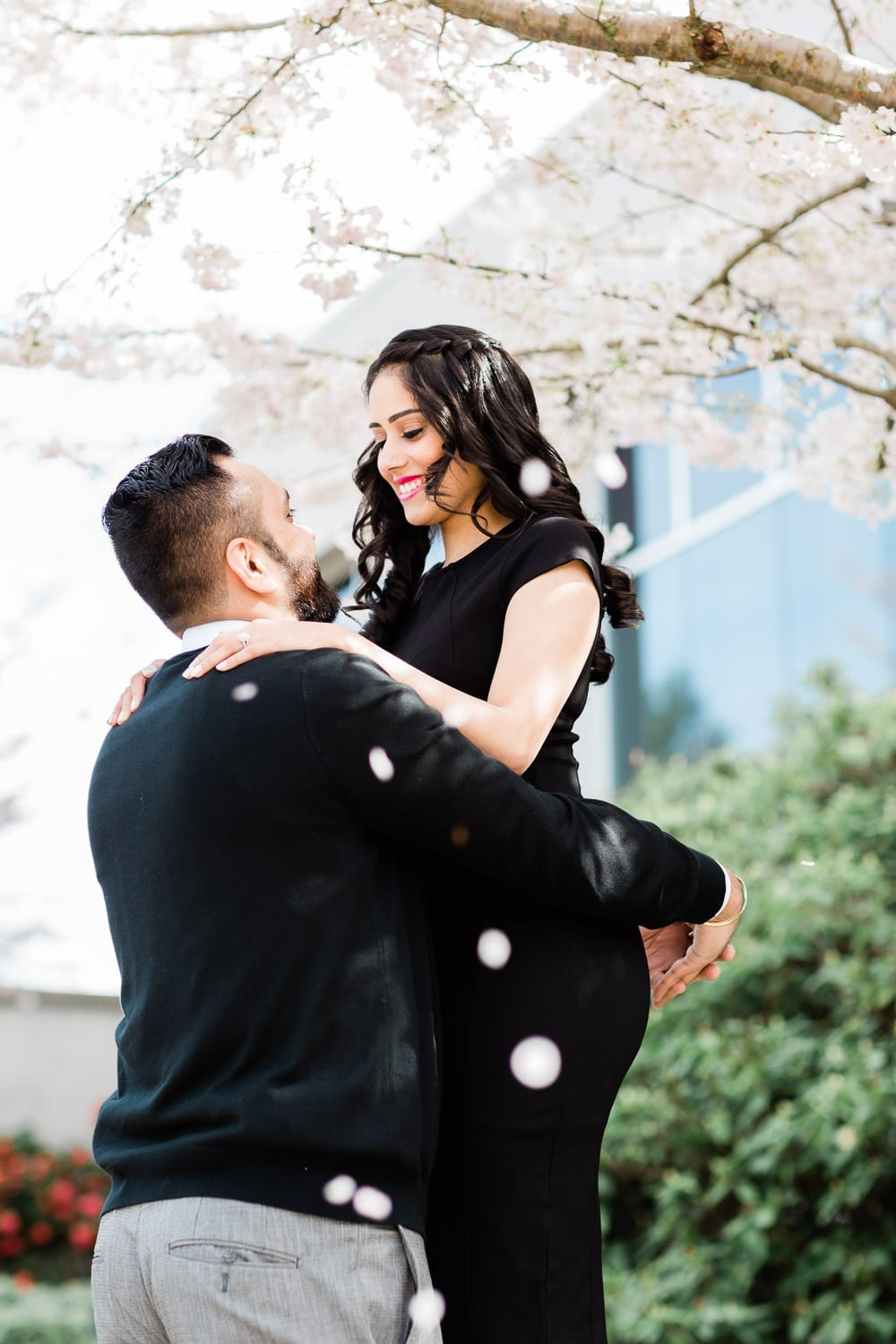 Engagement photo with cherry blossoms | Vancouver wedding photographer