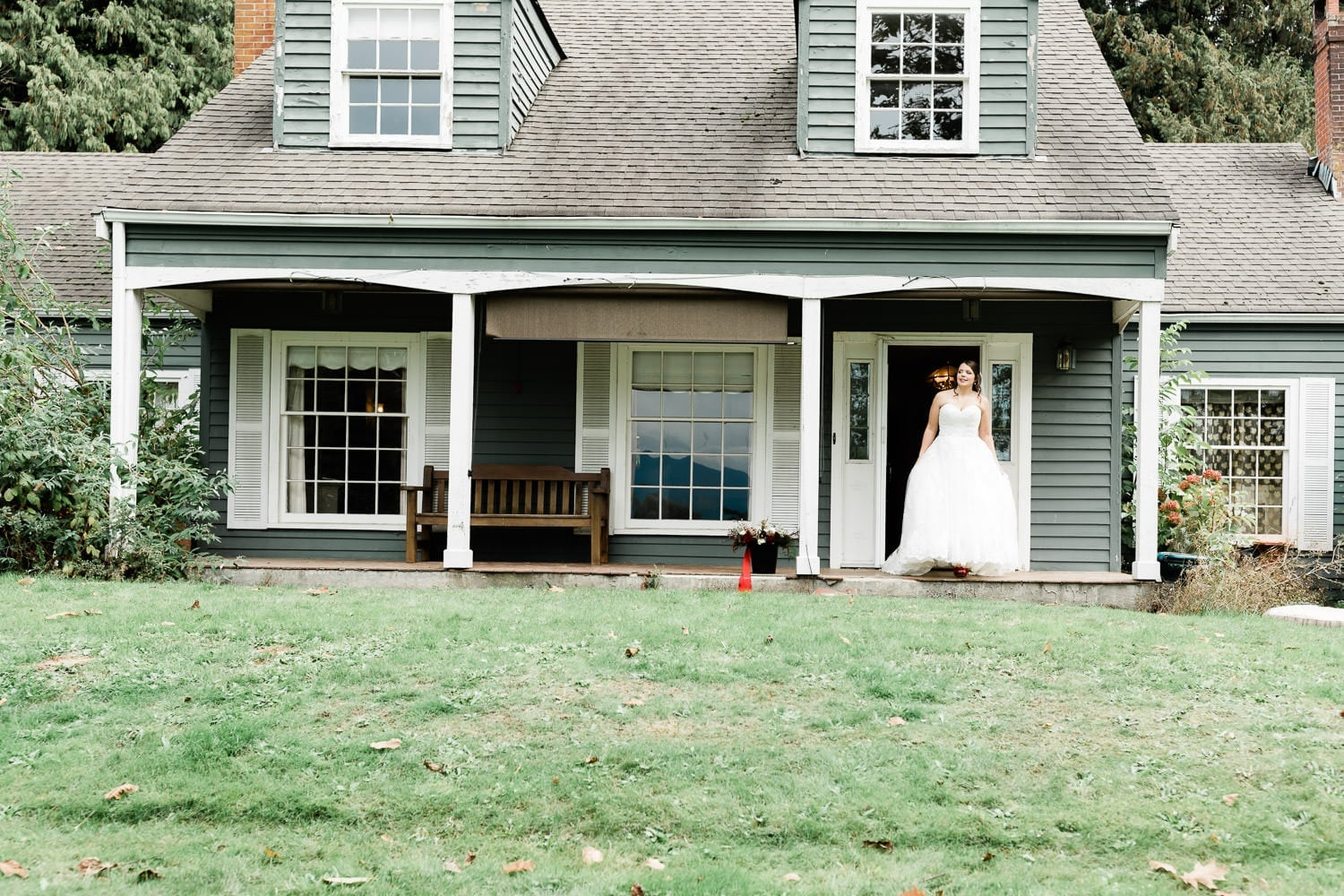 Bride posing on the porch | Vancouver wedding photographer