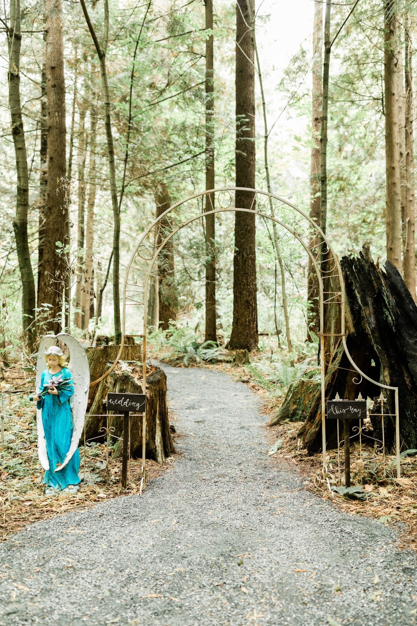 Rustic arch decoration in the woods | Vancouver wedding photographer