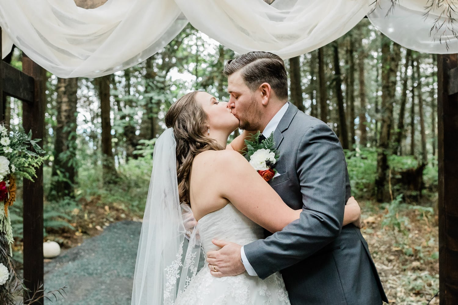 Rustic wedding ceremony photo in Langley and first kiss | Vancouver wedding photographer