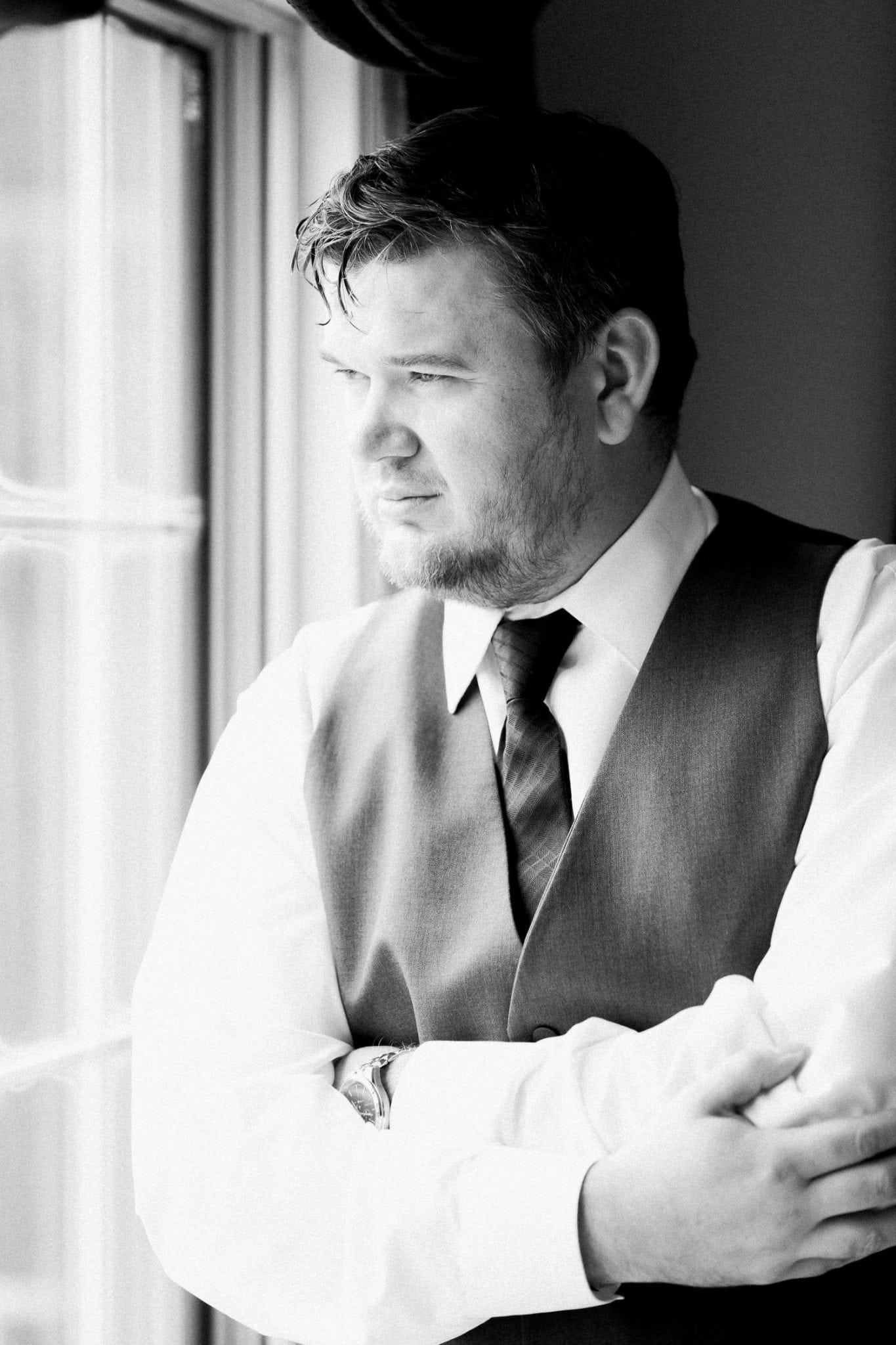 Groom during morning prep in b/w | Vancouver wedding photographer