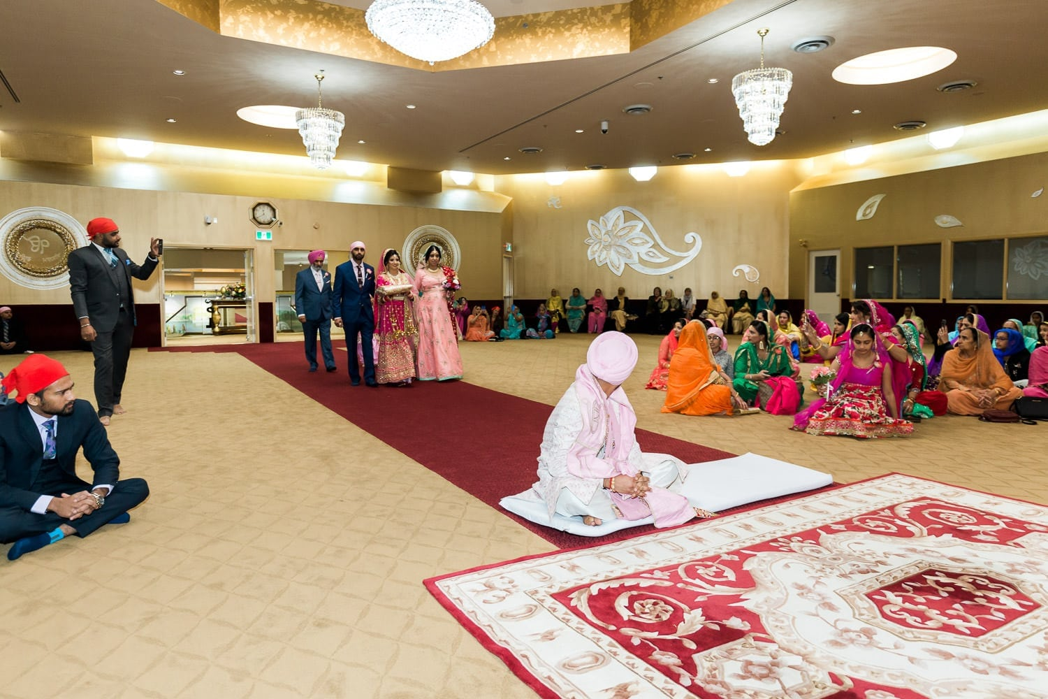 Indian groom seeing bride for the first time at the temple | Indian wedding photography Vancouver
