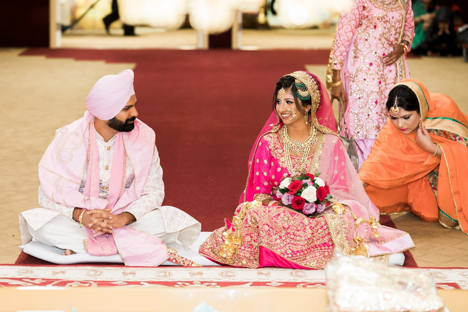 Indian bride and groom smiling at each other at the temple | Indian wedding photography Vancouver
