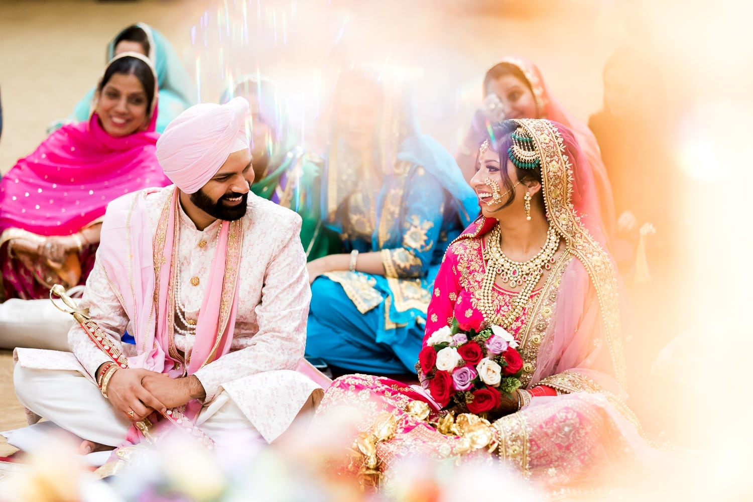 Indian bride and groom smiling at each other at the temple, Gurdwara Nanak Niwas | Indian wedding photography Vancouver