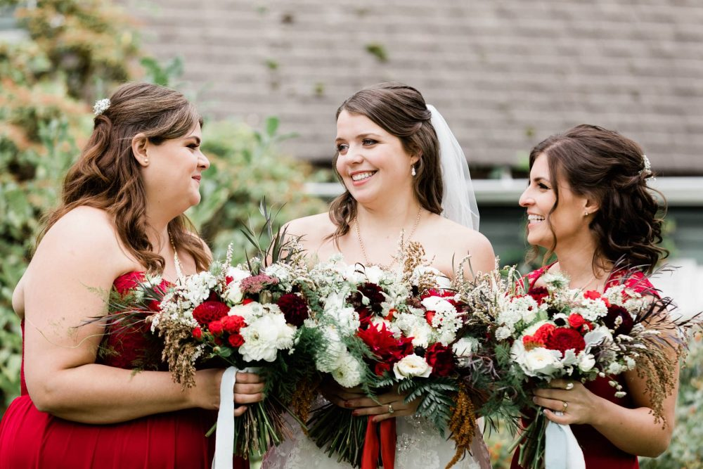 Bride and her brides mates happy chatting | Vancouver wedding photographer