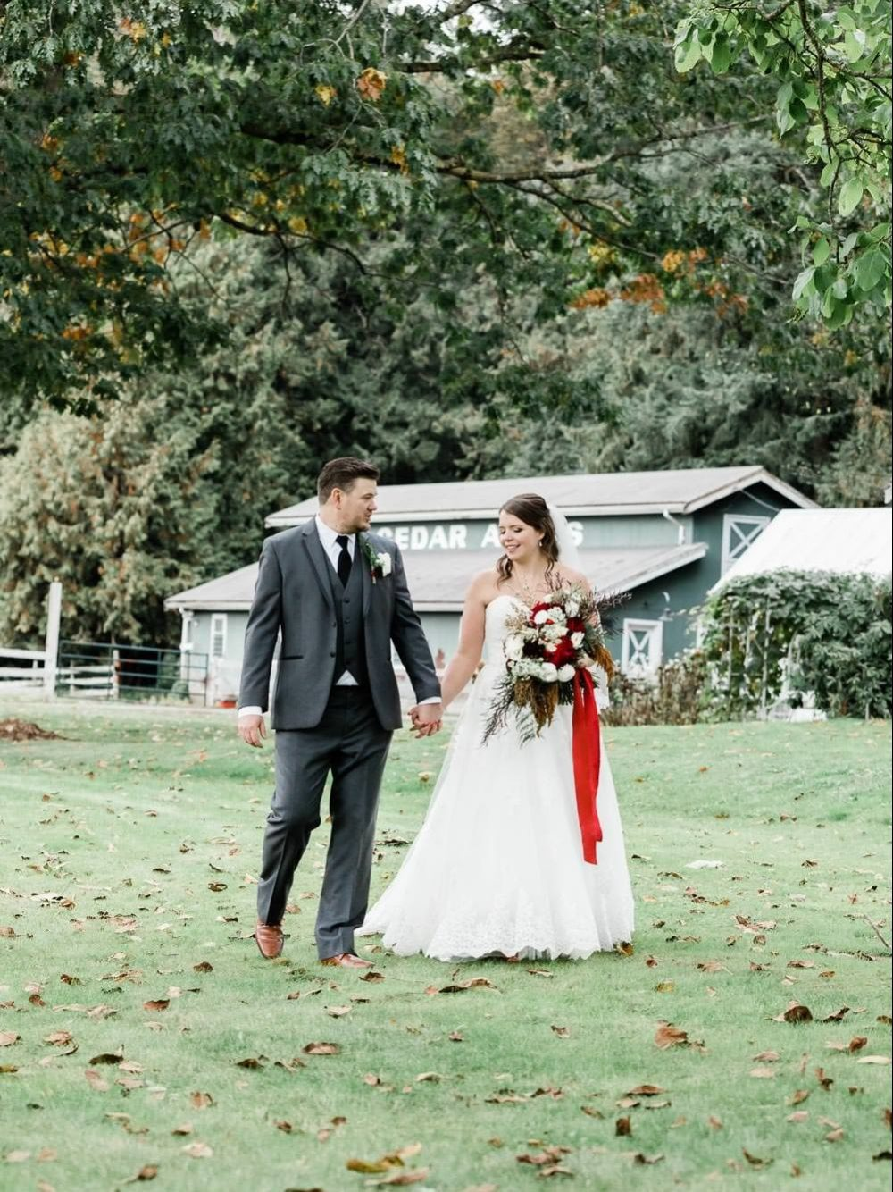 Bride and groom walking in the park | Vancouver Weddings Photographer