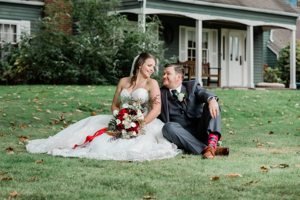 Happy bride and groom posing on the grass | Vancouver wedding photographer