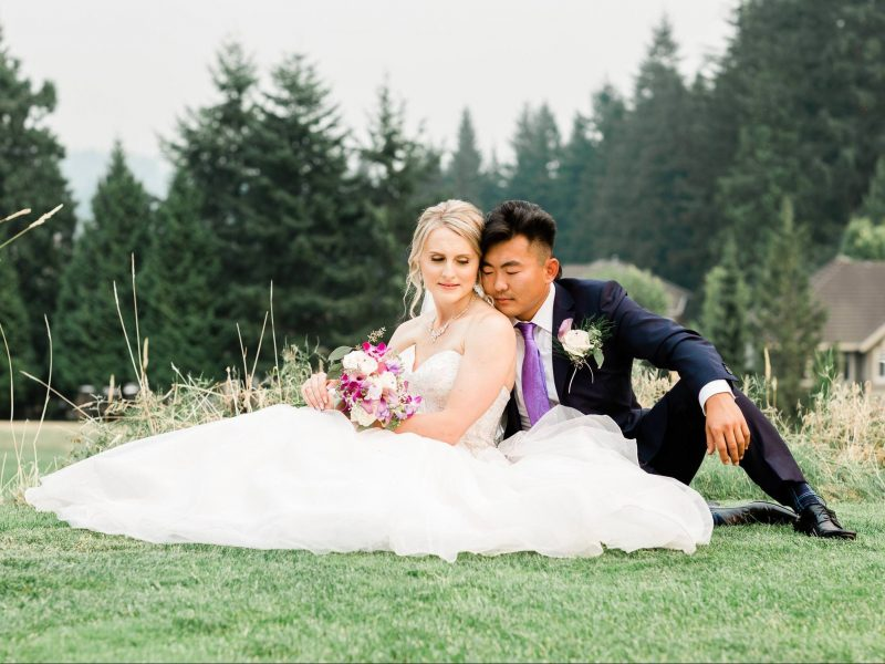 Bride and groom posing on the grass | Vancouver wedding photographer