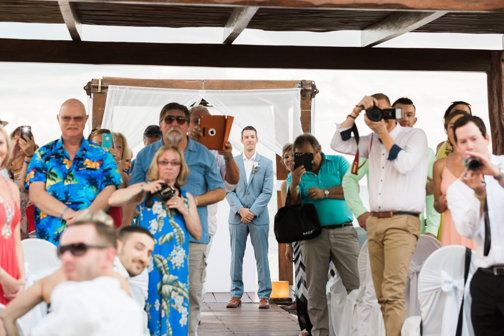 Groom and guests with cameras before the ceremony | Vancouver wedding photographer