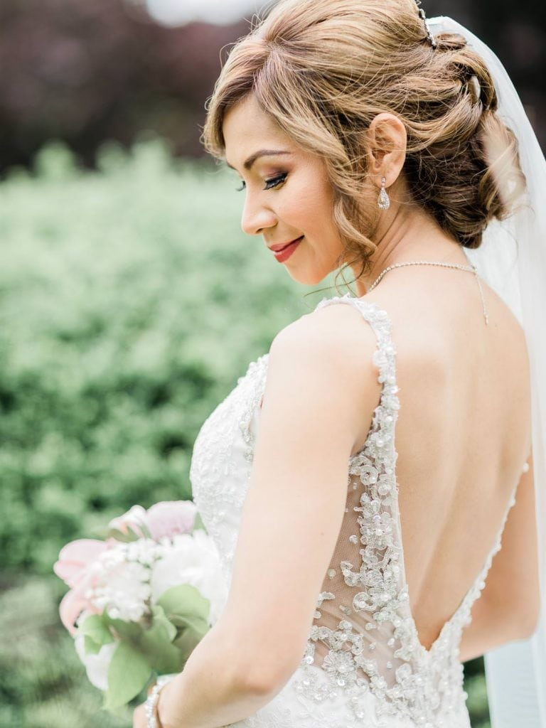 Bride posing with flowers   Vancouver wedding photographer