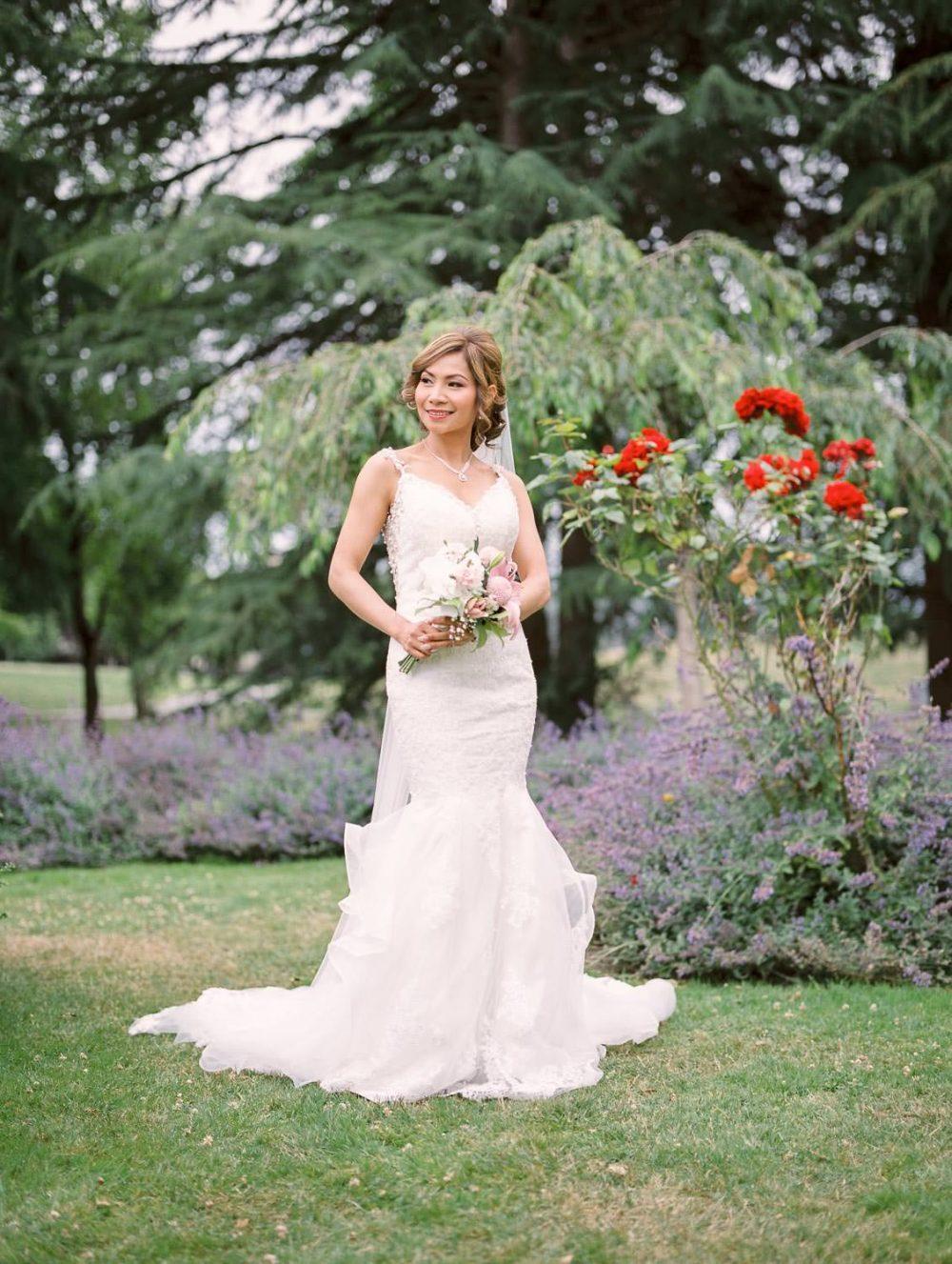 Bride posing in Minoru park | Vancouver wedding film photographer