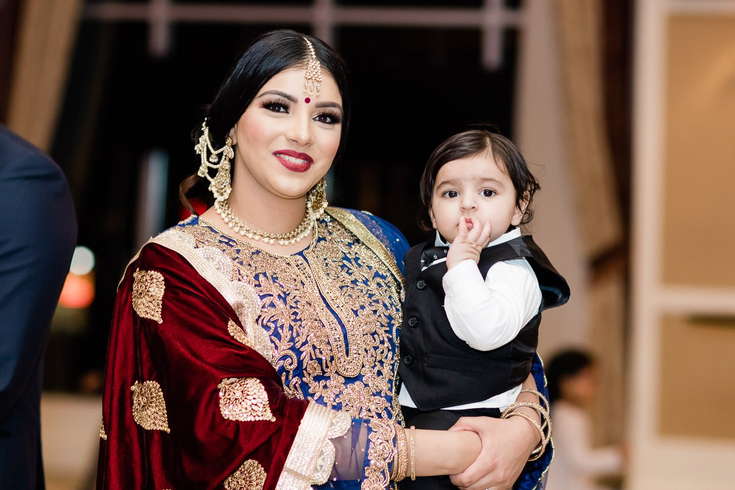 Indian bride holding a baby at the first Lohri
