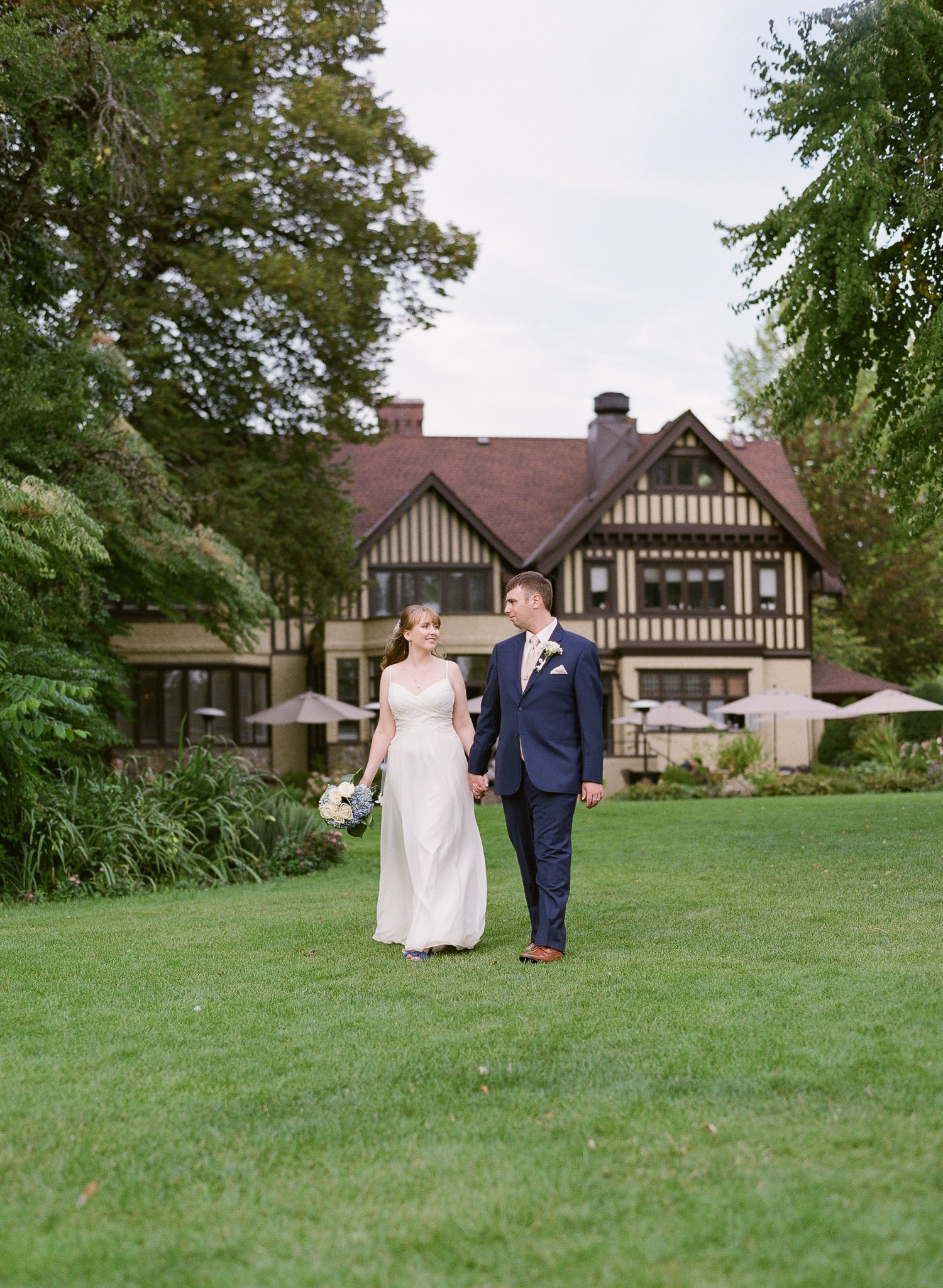 Newlyweds walking during photo session in front of the Vancouver wedding venue