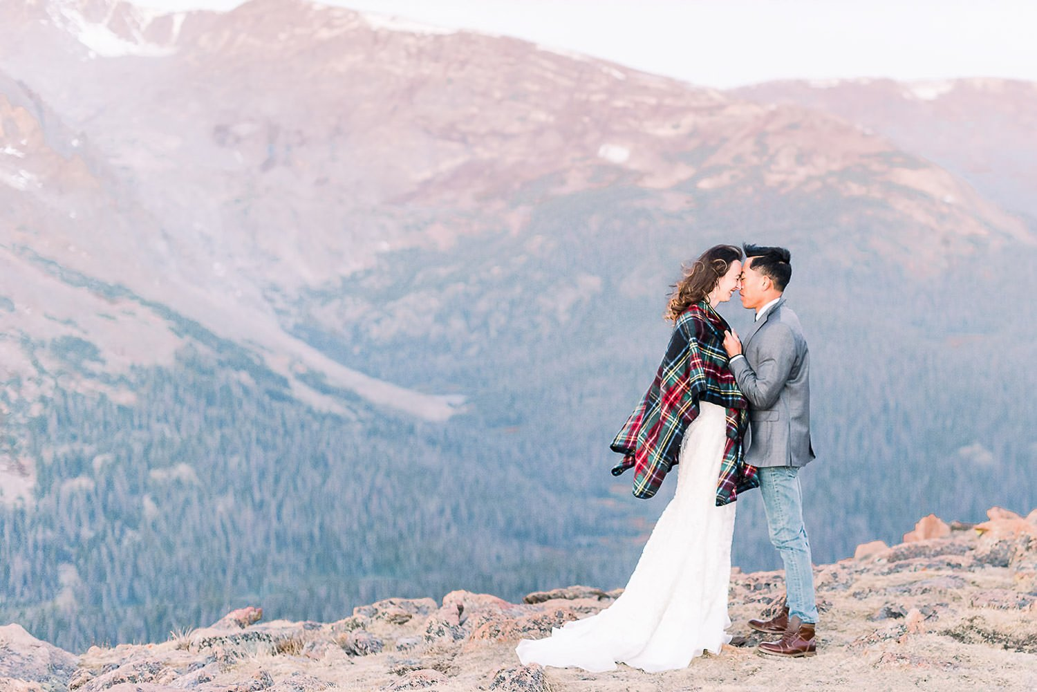 bride and groom standing on the cliff at the best photography location