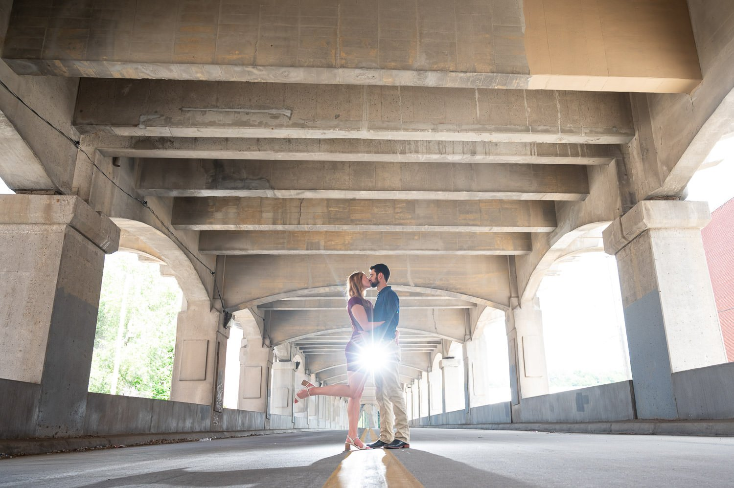 couple kissing during photoshoot